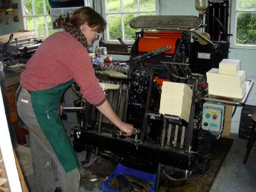 Luisa Hare at work with letterpress printer